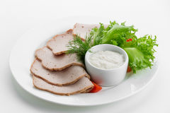 Sliced meat plateau ham with sauces and salad on white plate Stock Images