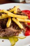 Sliced Meat and Potatos Stock Photos