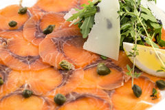 Sliced meat salmon. With fresh herbs and lemon Stock Photography