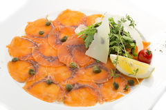 Sliced meat salmon. With fresh herbs and lemon Royalty Free Stock Photo