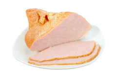 Sliced meat on white plate Stock Photos