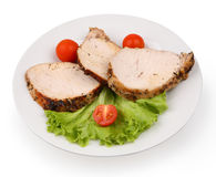 Sliced meat on a white plate royalty free stock photography