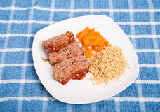Sliced Meatloaf with Brown Rice and Carrots Royalty Free Stock Photography