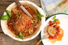 Sliced meatloaf in a casserole on a rustic table with copy space Stock Photos