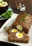 Sliced meatloaf with egg Stock Photo