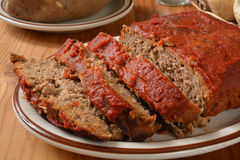 Sliced meatloaf. Meatloaf with tomato paste on a serving plate Stock Photo