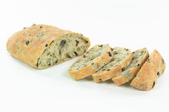 Sliced Mediterranean Ciabatta Black olive bread. Royalty Free Stock Photo