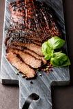 Sliced medium grilled beef steak Stock Photo