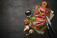 Sliced medium rare grilled beef ribeye steak Royalty Free Stock Image