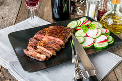 Sliced medium rare grilled Beef steak Ribeye Stock Image