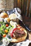 Sliced medium rare grilled Beef steak Ribeye on cutting board on Stock Image