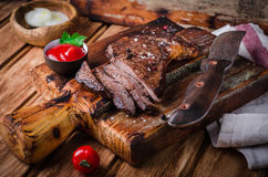 Free Sliced Medium Rare Grilled Beef Steak  With Spices And Ketchup  On Cutting Board On Wooden Background Royalty Free Stock Photography - 72768427