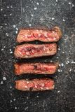 Sliced medium rare grilled steak Royalty Free Stock Photos