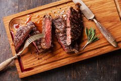 Sliced medium rare grilled steak Ribeye with rosemary Royalty Free Stock Photography