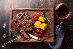 Sliced Medium rare Steak Ribeye with corn and cherry tomatoes Stock Photo