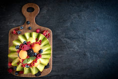 Sliced melon with berry fruit Stock Photos