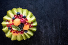 Sliced melon with berry fruit Royalty Free Stock Images