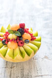 Sliced melon with berry fruit Royalty Free Stock Photography