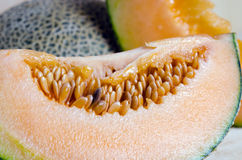 Sliced melon with seed on wooden board (Other names are cantelop Royalty Free Stock Images