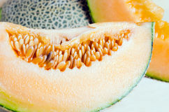 Sliced melon with seed on wooden board Other names are cantelop Stock Photos