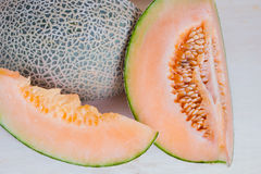 Sliced melon with seed on wooden board Royalty Free Stock Photo