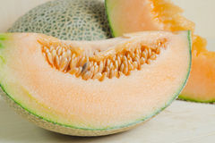 Sliced melon with seed on wooden board (Other names are Melon, c Royalty Free Stock Image