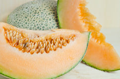 Sliced melon with seed on wooden board (Other names are Melon, c Royalty Free Stock Photo