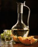 Sliced melon and white wine Stock Images