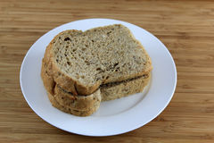 Sliced multigrain Bread on the white plate Royalty Free Stock Image