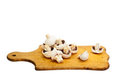 Sliced mushrooms on a board Stock Photography