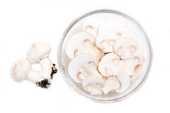 Sliced mushrooms in bowl from above Stock Photography
