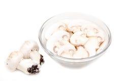 Sliced mushrooms in bowl Stock Photo