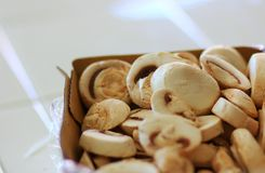 Sliced mushrooms in a cardboard container Stock Images