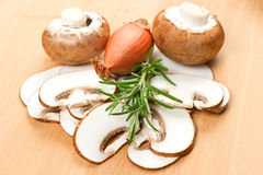 Sliced mushrooms on a cutting board Stock Image