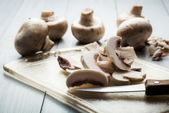 Sliced mushrooms on a cutting board Stock Photos