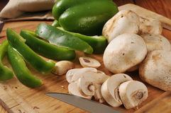 Sliced mushrooms and green peppers Royalty Free Stock Photo