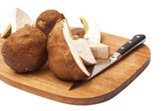Sliced mushrooms with knife Royalty Free Stock Images