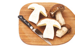 Sliced mushrooms with knife on a cutting board Stock Photography