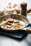 Sliced mushrooms with onion on a pan Royalty Free Stock Image