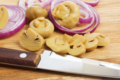 Sliced mushrooms and onions Royalty Free Stock Photos