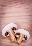 Sliced Mushrooms over wooden background Stock Photography