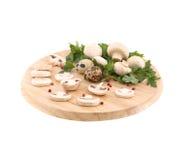 Sliced mushrooms on platter. Stock Photos