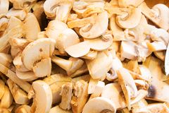 Sliced mushrooms top view. Sliced mushrooms champignons top view flat lay close up stock images