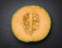 Sliced musk melon  on slate. Stock Image