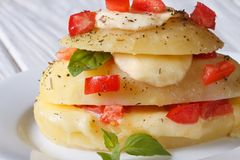 Sliced new potatoes stuffed with mozzarella, tomatoes close-up Royalty Free Stock Photography