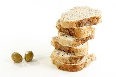 Sliced olive bread. Sliced olive and tomato bread  wit two olives on a white background Royalty Free Stock Image