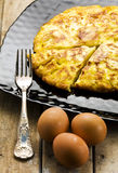 Sliced Omelet Silver Fork and Whole Eggs Royalty Free Stock Photos