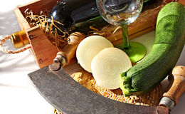 Sliced onion. Fresh onion and courgette on cutting board Royalty Free Stock Image