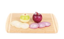 Sliced onion on cutting board. Stock Images