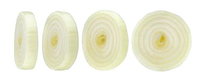 Sliced onion isolated on white background. With clipping path royalty free stock images